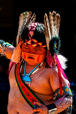 A Native American boy from the Tewa Dance Troupe Nambe Pueblo performing at the Indian Pueblo Culture Center, Albuquerque, New Mexico USA