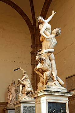 The Rape of the Sabine Women by the Flemish artist Jean de Boulogne Giambologna Made from one imperfect block of white marble, the largest block ever transported to Florence The Loggia dei Lanzi, also called the Loggia della Signoria, Piazza della Sign