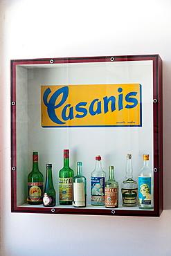 France, Corsica, Haute-Corse Department, Central Mountains Region, Corte, Citadel, Musee de la Corse museum, old bottles of Corsican liquers