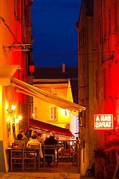 France, Corsica, Haute-Corse Department, La Balagne Region, Ile Rousse, outdoor cafes, dusk