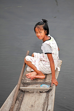 Young Intha girl Siteting in her flat-bottomed boat, Inle Lake, Shan state, Myanmar, Burma