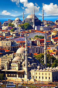 The Yeni Camii, The New Mosque or Mosque of the Valide Sultan foreground ordered by Safiye Sultan in 1597 on the banks of the Golden Horn, Istanbul Turkey