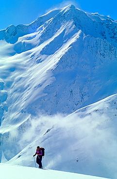 One man on ski walking uphill in remote part of Otztal Alps, Austria