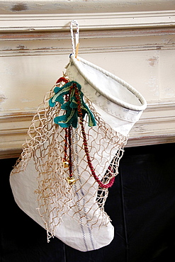 A Christmas stocking made from sailcloth, at the Atlantic Workshop in Chatham, Cape Cod, Massachusetts