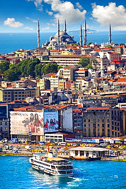The Suleymaniye Mosque Suleymaniye Camii, 1550-1558 on the Third Hill with a ferries on the banks of the Golden Horn in the foreground, Istanbul Turkey