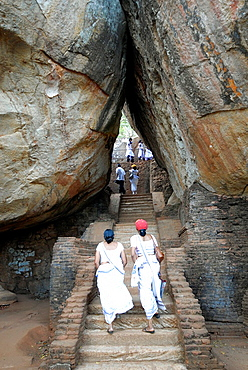 two women climbing the steps to the lions terrace at Sigiriya, Sri Lanka
