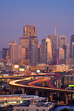 San Francisco, California, USA: financial district at sunrise, 280 freeway with car light trails, view from Potrero Hill