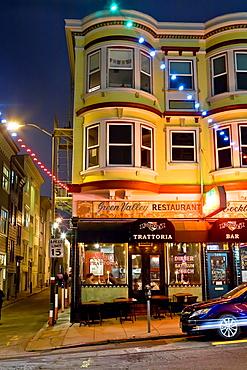 Green Street, North Beach area, San Francisco, California, USA: Victorian style building with Italian restaurant, bar, and apartments, night