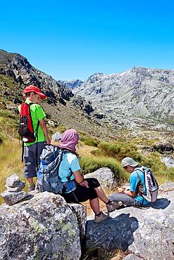 Mountaineers resting in Sierra de Gredos Regional Park, Â¡vila Castilla y Leon Spain