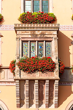 Decorated windows on a house in Obernai, Alsace, France, Europe