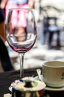 Empty Cup of wine on terrace bar of Laguardia village, La Rioja, Spain