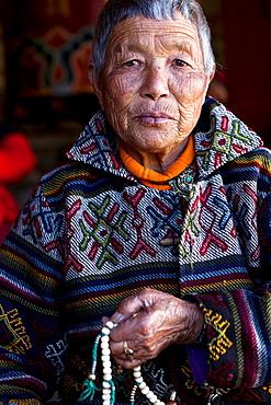 Portrait of a bhutanese old woman at the Memorial Chorten, Thimphu, Bhutan, Asia.