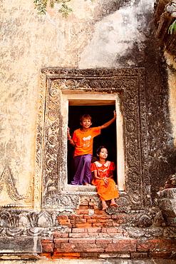 Young Boy and girl Playing near Temple in Bagan, Myanmar, Burma