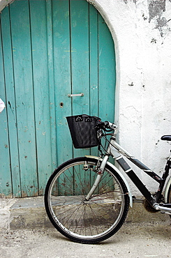 Bicycle with basket leaning against wall in old town Rethymnon Crete Greece
