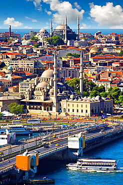 The Yeni Camii, The New Mosque or Mosque of the Valide Sultan foreground ordered by Safiye Sultan in 1597 on the banks of the Golden Horn and the Galata bridge, Istanbul Turkey