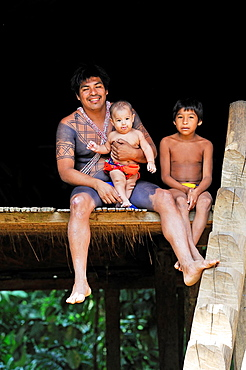 man and children of Embera native community living by the Chagres River within the Chagres National Park, Republic of Panama, Central America