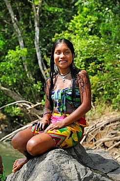Esilda by the river, young teenager of Embera native community living by the Chagres River within the Chagres National Park, Republic of Panama, Central America