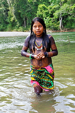 little girl bathing at the river, Embera native community living by the Chagres River within the Chagres National Park, Republic of Panama, Central America
