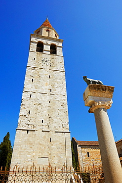 Patriarchal Basilica of Santa Maria Assunta Belltower and column with Capitoline Wolf, Aquileia, Friuli-Venezia Giulia, Italy