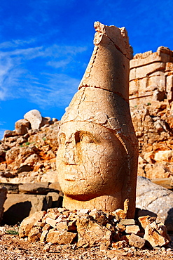 Picture & photo of the statues of around the tomb of Commagene King Antochus 1 on the top of Mount Nemrut, Turkey Stock photos & Photo art prints In 62 BC, King Antiochus I Theos of Commagene built on the mountain top a tomb-sanctuary flanked by huge statues 809 m/2630 ft high of himself, two lions, two eagles and various Greek, Armenian, and Iranian gods The photos show the broken statues on the mountain top