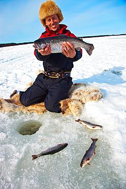 Fishing salmon on the ice Javrebodarna fiskecamping JavrebodarnaSkelleftea Vasterbotten, Lapland, Sweden, Scandinavia