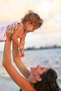 Mother and toddler daughter on beach