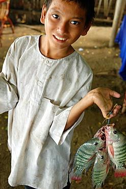 Boy and his fish Amarapura Mandalay Division Burma Republic of the Union of Myanmar.