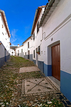 Typical alley with 'Llanos' on the ground , Linares de la Sierra, Huelva-province, Spain