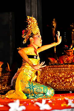 Asia, South-East Asia, Indonesia Bali, Ubud. A Girl Performing The legong Tantri Dance.