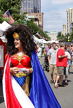 A man portraying Wonder Woman in drag promotes AIDS awareness at SPARKcon, a creative arts festival in Raleigh, North Carolina, USA
