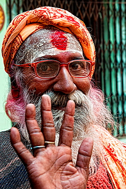 Sadhu saying hello in the streets of Varanasi, Benares, Uttar Pradesh, India