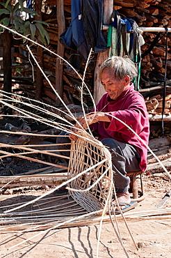 ethnic Yao man making a basket, Muang Singh, Laos