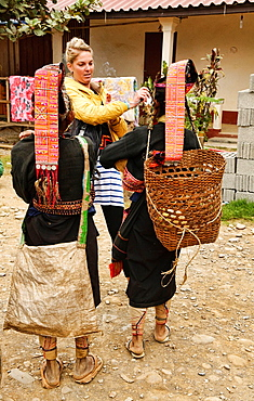 Akha women greeting a tourist, Phongsaly, Laos