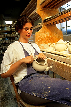 skilled worker deburring some pieces, earthenware factory of Niderviller, Moselle department, Lorraine region, France, Europe