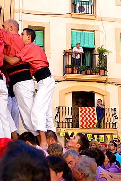 Colla Vella dels Xiquets de Valls 'Castellers' building human tower, a Catalan tradition Festa de Santa Tecla, city festival Placa de la Font Tarragona, Spain