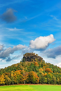 View to the Zirkelstein rock. The Zirkelstein is the smallest table mountain in the national park Saxon Switzerland. It is a wooded, cone-shaped hill with a striking 40 metre high summit rock of sandstone, municipality Reinhardtsdorf-Schoena, near Dresden, Saxony, Germany, Europe