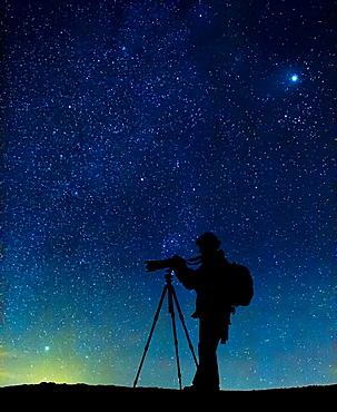 Silhouette of photographer with starry skies, Iceland digital composite Steinsholtsjokull Glacier part of Eyjafjallajokull Ice Cap, Iceland