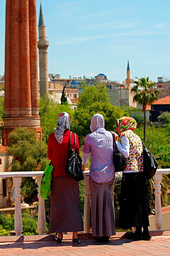 Three Turkish young woman look at the historic centre Antalya, Turkey, Western Asia
