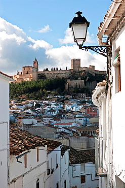 Typical street of Alcala la Real, Spain, in the background the castle of La Mota