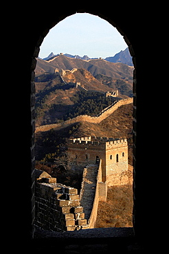 The Great Wall of China through the door of a watch tower. China, Beijing, Jinshanling, Great Wall