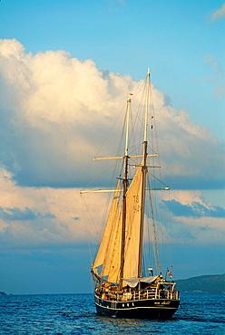 sailing boat off the coast of La Digue island, Republic of Seychelles, Indian Ocean