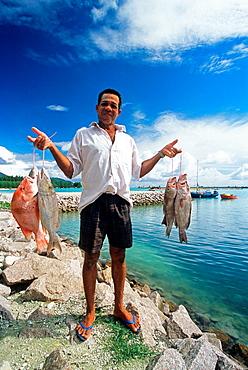 fisherman showing fish, Mahe island, Republic of Seychelles, Indian Ocean