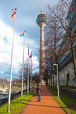 Am Handelshafen footpath with Rheinturm tower Hafen district Dusseldorf city North Rhine Westphalia region western Germany Europe.