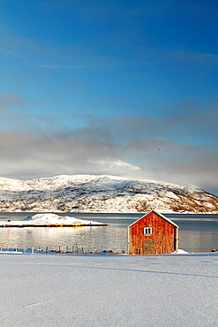 Cottage in a fjord near Tromso, Norway.