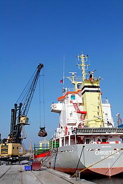 France, Brittany, Ille et Vilaine. Unloading cargo in the port of Saint Malo
