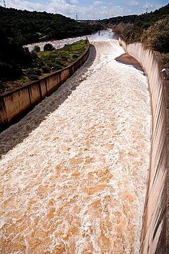 Torrent of water expelled the river of Guadalmellato, Spillway in the reservoir of San Rafael de Navallana, near Cordoba, Andalusia, Spain