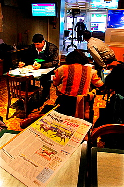 Equestrian bets in a 'PMU Cafe' at La Rochefoucault, Charente, Poitou-Charentes, France