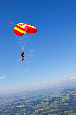 Person parachuting over Thurgau, Switzerland