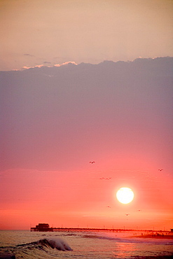 sun setting over Newport Beach California