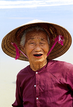 Hoi An, Beach, old Woman, Traditional Costume, Woman wearing traditional conical Hat, Vietnam.